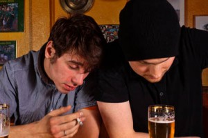 two men drunk at bar