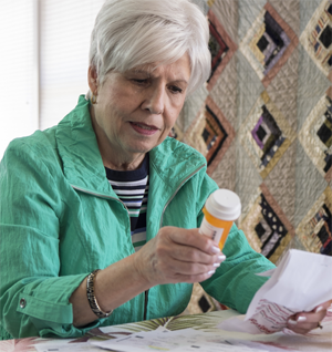 older woman with pills