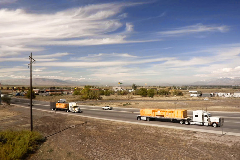 """The """"Something Can Be Done About It"""" convoy carries 200 tons of building supplies, donated by KSL and Bonneville Radio viewers and listeners. The convoy itself was organized and paid for by the Scientology Volunteer Ministers."""