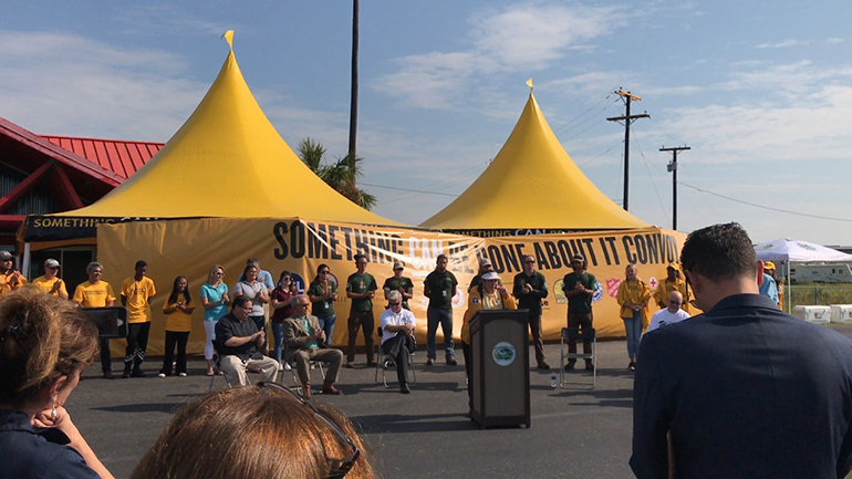 Joava Good, Deputy National Director of Churches of Scientology Disaster Response, at the ceremony at Aransas County Airport welcoming the Something CAN Be Done About It convoy filled with materials to rebuild local homes.