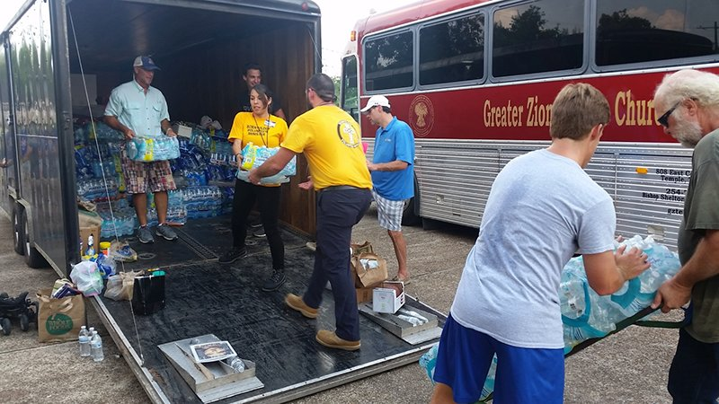 Scientology Volunteer Ministers distribute water to hurricane victims.