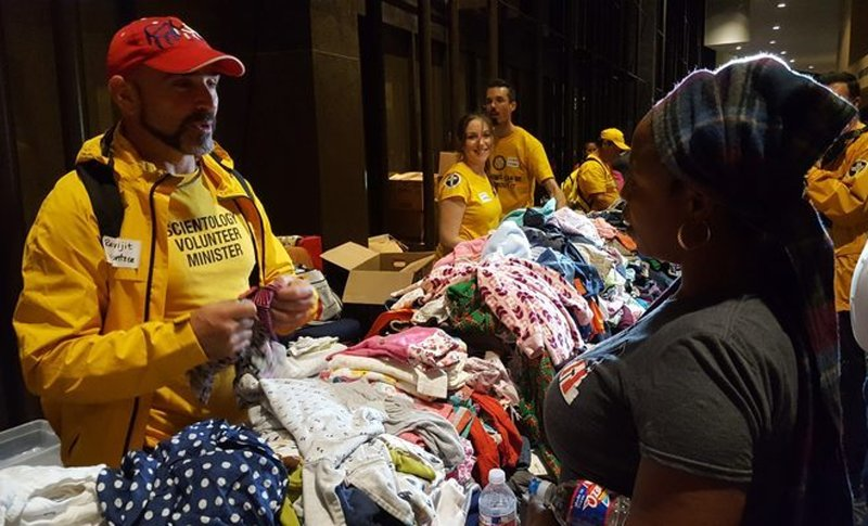 Scientology Volunteer Ministers helping people displaced by Hurricane Harvey at Houston's Lakewood Church