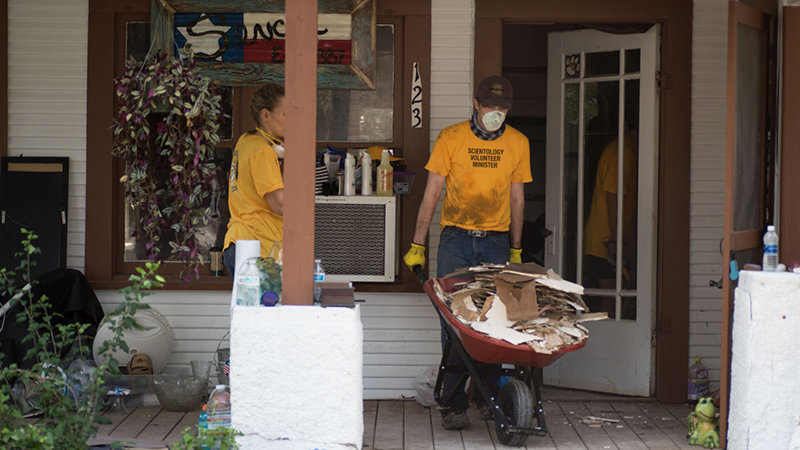 Scientology Volunteer Ministers help muck out a home that was flooded by Hurricane Harvey.