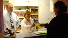 Employees enjoy distributing copies of The Way to Happiness to their customers and associates.