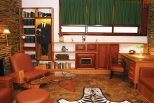 Mr. Hubbard's study, including the reference books, zebra rug, African artifacts, and motion picture camera he used in South Africa.
