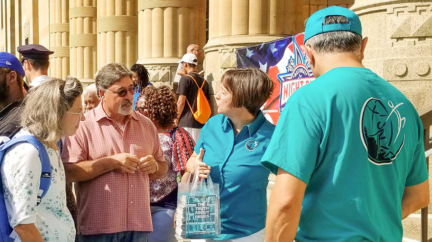 Drug-Free World provides material at the launch of Buffalo's National Night Out activities at City Hall.