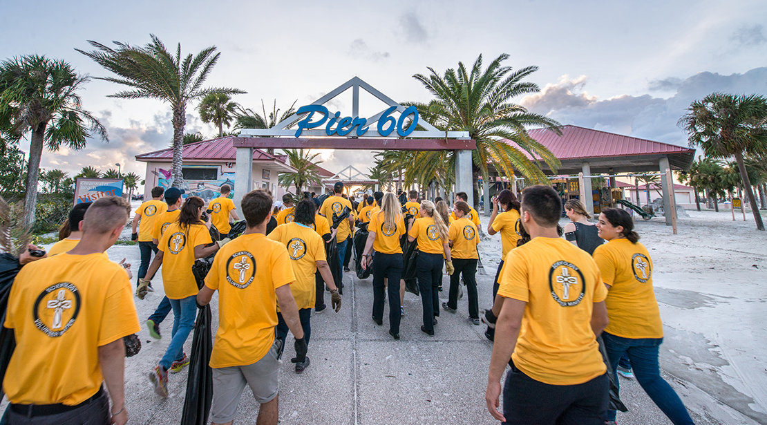 Volunteer Ministers walk into the beach