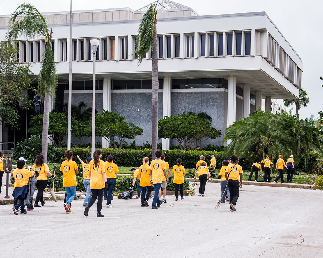 Volunteer Ministers clean up tons of storm-felled trees from Clearwater's City Hall