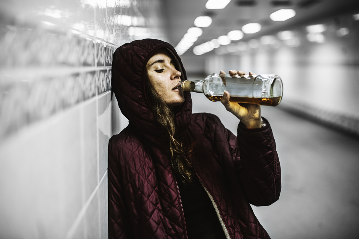 Woman drinking in the tunnel