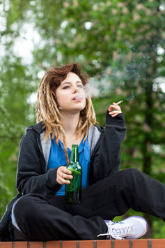 A young girl smoking marijuana.