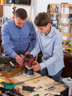 Father and son working on a project together.