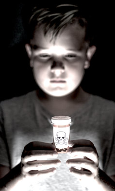 Little boy holding deadly prescription drugs.