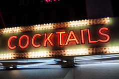 neon sign advertising cocktails