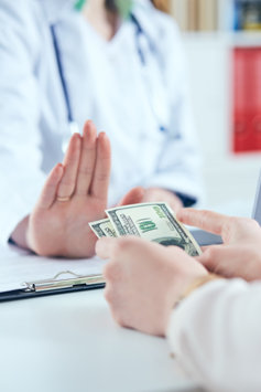 A Doctor is refusing money
