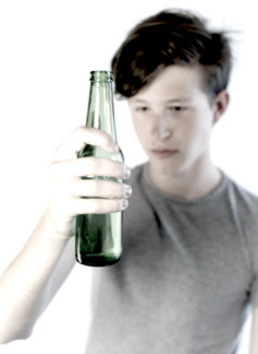 Teenager boy holding alcohol.
