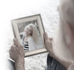Father is holding a photo of his daughter.