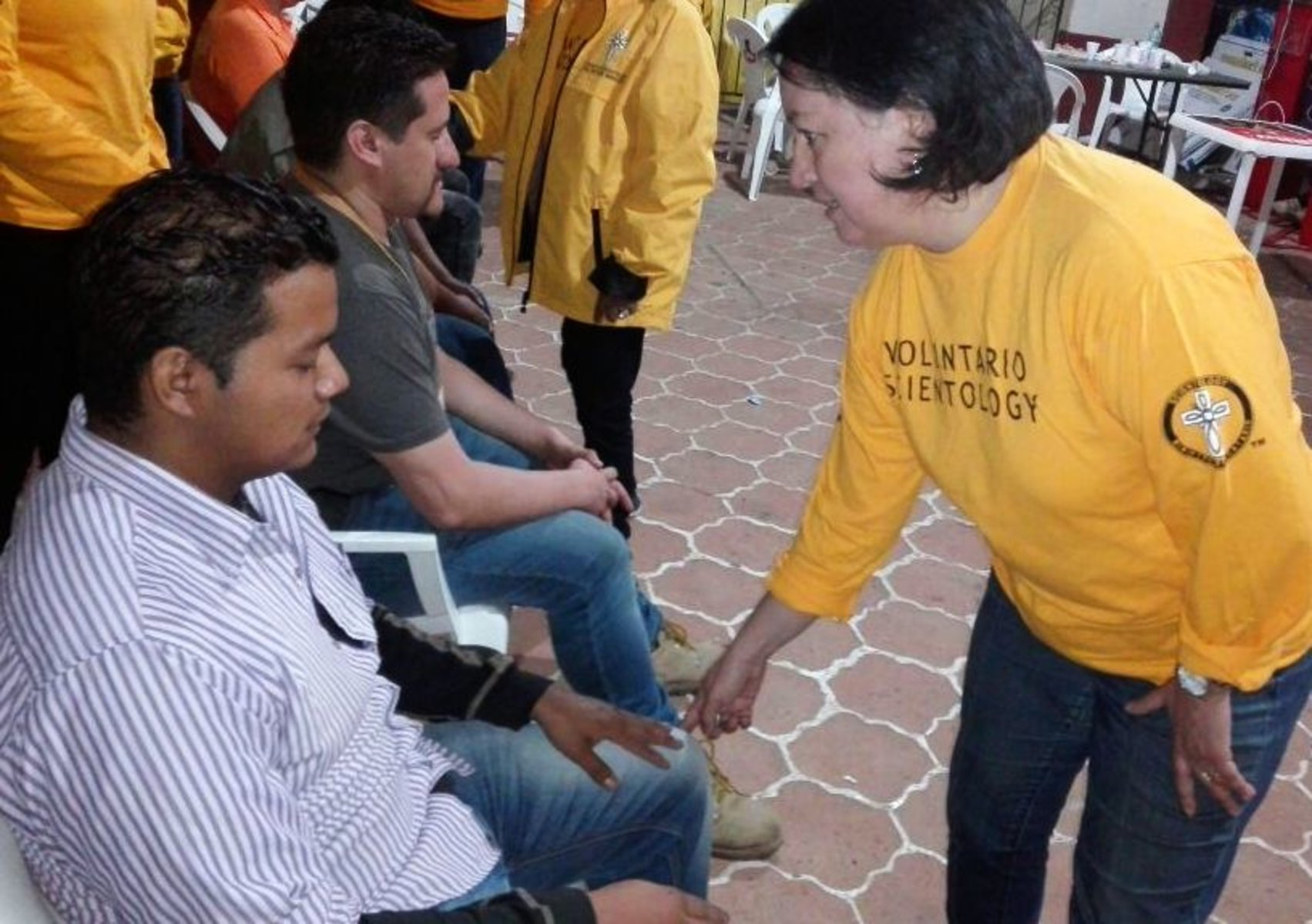 A Volunteer Minister provides relief using a Scientology assist to reduce pain, stress and trauma