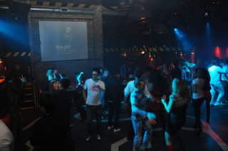 Patrons of the Almaty Da Freak Club, party while Youth for Human Rights PSAs play throughout the night.
