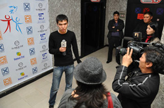 Youth for Human Rights Kazakhstan's chief organizer is interviewed on television.