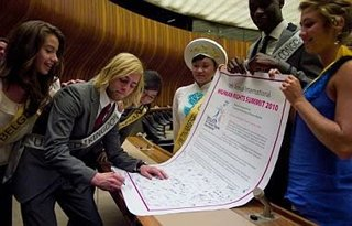 Niki Lanik signing a petition for human rights at the Seventh Annual International Human Rights Summit in Geneva.