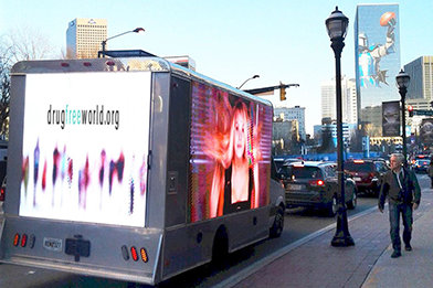 A large mobile jumbotron screen circulated in downtown Atlanta for several days, airing the Drug-Free World PSAs.