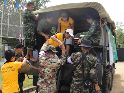 VMs arrive at a flood relief coordination site manned by the Thai army.