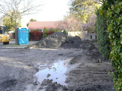 Following the 7.1 earthquake, mounds of toxic silt contaminated the streets of Christchurch.