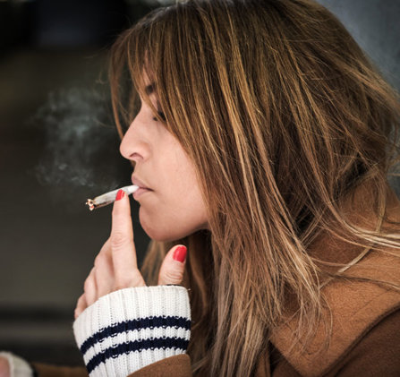 Girl smoking marijuana.
