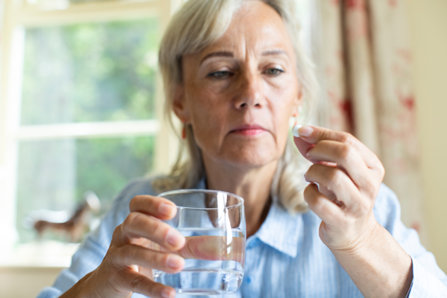 Woman taking pain reliever