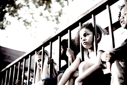 Sad kids sitting on balcony.