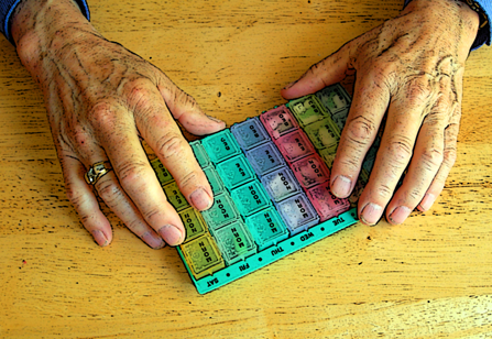 A pill case helps a senior citizen keep her pills straight.