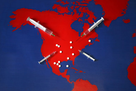 Red map of North American cont covered with drugs.