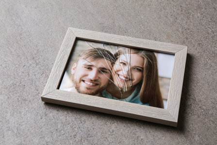 Crashed picture frame of a couple.