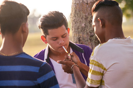 Hispanic teenagers smoking pot.