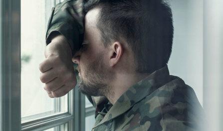 Soldier leans against window