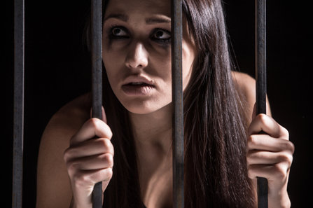 Woman scared behind the bars