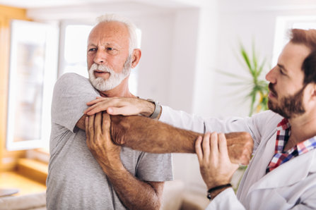 Chiropractor helping to handle pain.