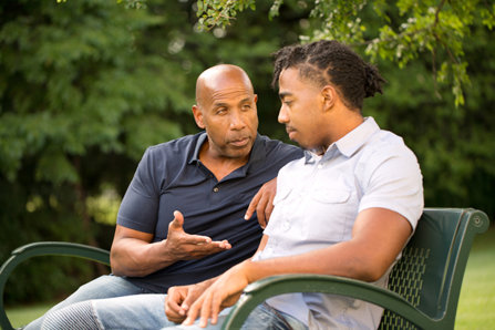 Father mentoring and giving advice to a younger man.