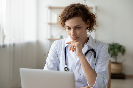 Physician is checking information on a computer