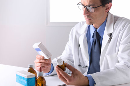 Doctor is closely inspecting drugs