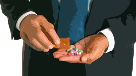 Executive hands with pills