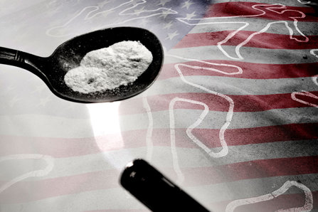 Cooking fentanyl on American flag background with chalk deadlines.