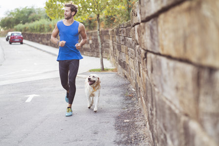Man is jogging with a dog
