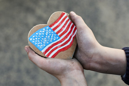 Holding heart with us flag