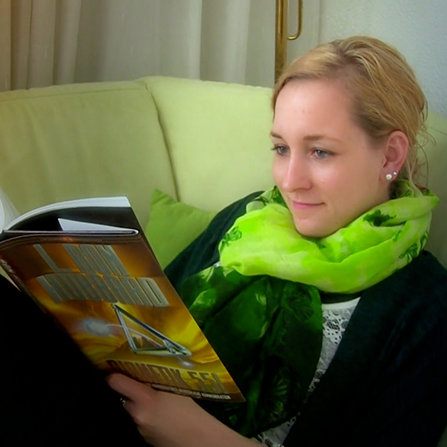 Ariane reading Dianetics 55! book by L. Ron Hubbard