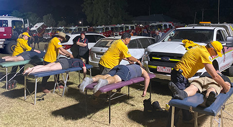 Firefighters receive much-needed assists after returning from an exhausting day of battling fires.