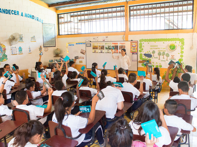 A teacher presents a drug education lecture to students in Honduras