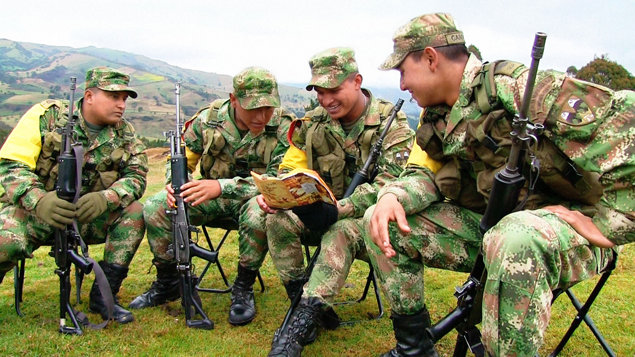 Colombian Army soldiers read from The Story of Human Rights.