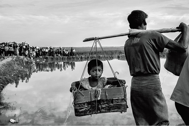 Driven from their homes by civil strife, some 700,000 Rohingya Muslims in Myanmar have crossed into Bangladesh, filling refugee camps there along the Naf River.