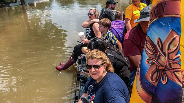 Volunteer Ministers rescued stranded Texans by canoe and boat.